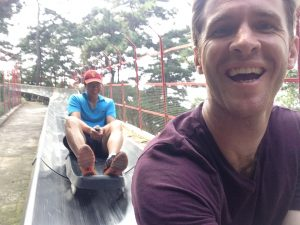 Sliding down on the metal luge at the Mutianyu Great Wall is fun for all the family.
